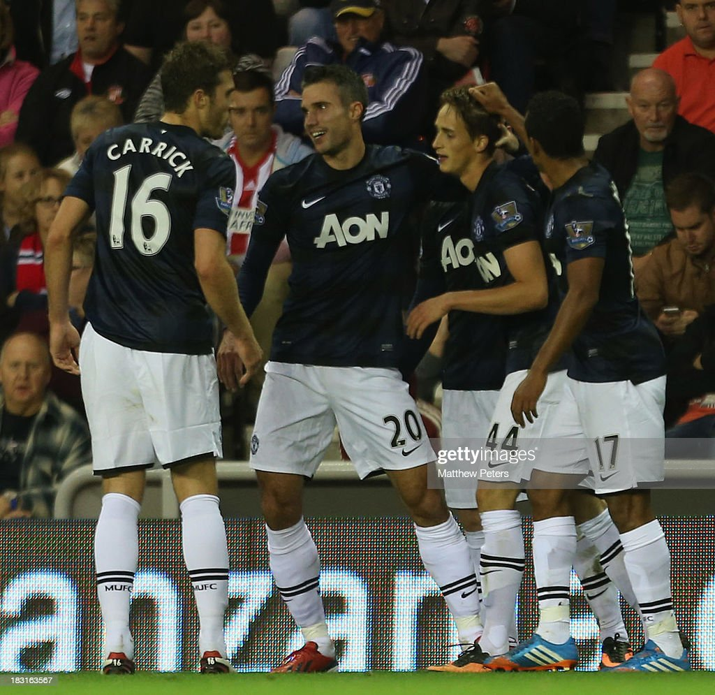 <a gi-track='captionPersonalityLinkClicked' href=/galleries/search?phrase=Adnan+Januzaj&family=editorial&specificpeople=8291259 ng-click='$event.stopPropagation()'>Adnan Januzaj</a> (2nd R) of Manchester United celebrates scoring their second goal during the Barclays Premier League match between Sunderland and Manchester United at the Stadium of Light on October 5, 2013 in Sunderland, England.