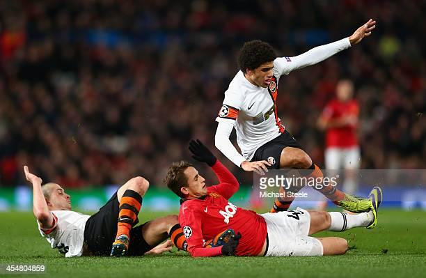 Adnan Januzaj of Manchester United challenges Taison of Shakhtar Donetsk during the UEFA Champions League Group A match between Manchester United and...