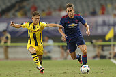 Adnan Januzaj of Manchester United competes for the ball with Jacob Bruun Larsen of Borussia Dortmund during the International Champions Cup match...