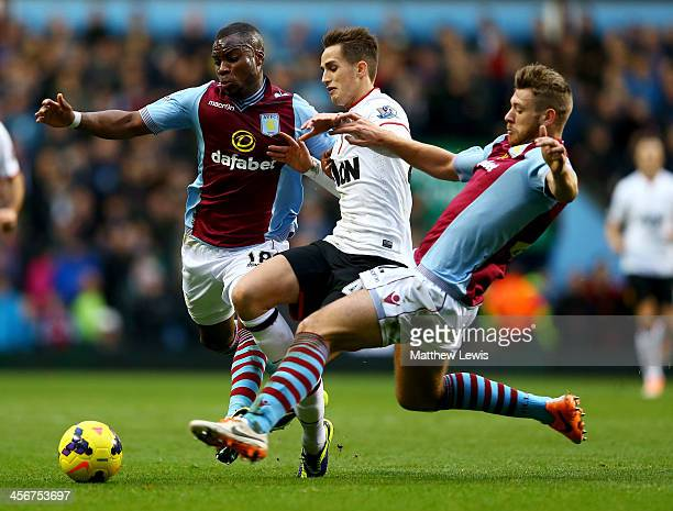 Adnan Januzaj of Manchester United goes between Yacouba Sylla and Nathan Baker of Aston Villa during the Barclays Premier League match between Aston...