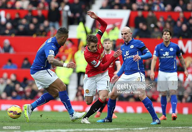 Adnan Januzaj of Manchester United in action with Danny Simpson and Esteban Cambiasso of Leicester City during the Barclays Premier League match...