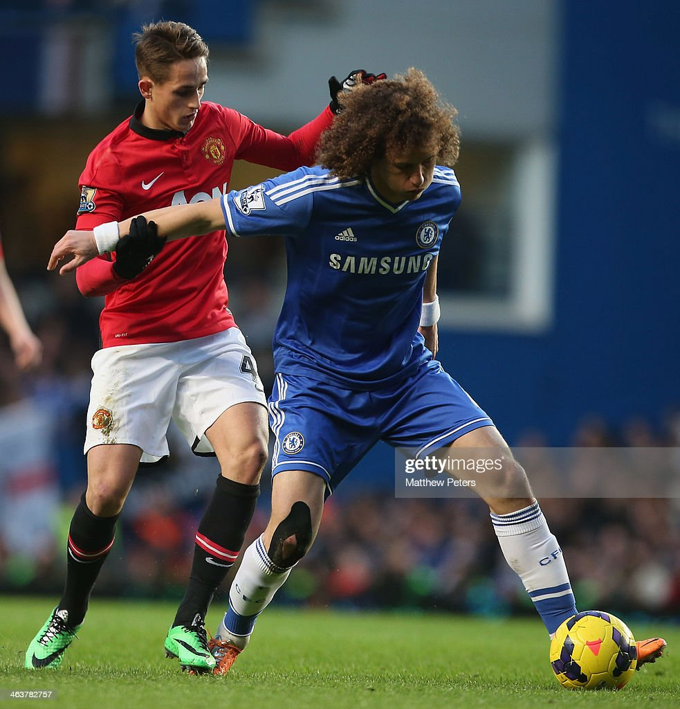 Adnan Januzaj of Manchester United in action with David Luiz of Chelsea during the Barclays Premier League match between Chelsea and Manchester United at Stamford Bridge on January 19, 2014 in London, England.