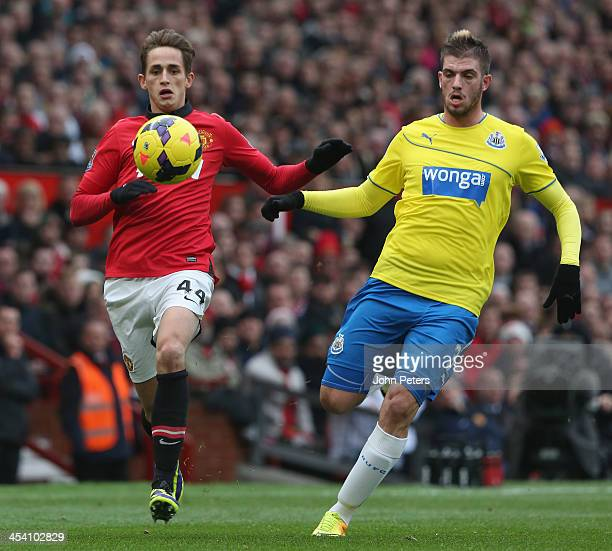 Adnan Januzaj of Manchester United in action with Davide Santon of Newcastle United during the Barclays Premier League match between Manchester...