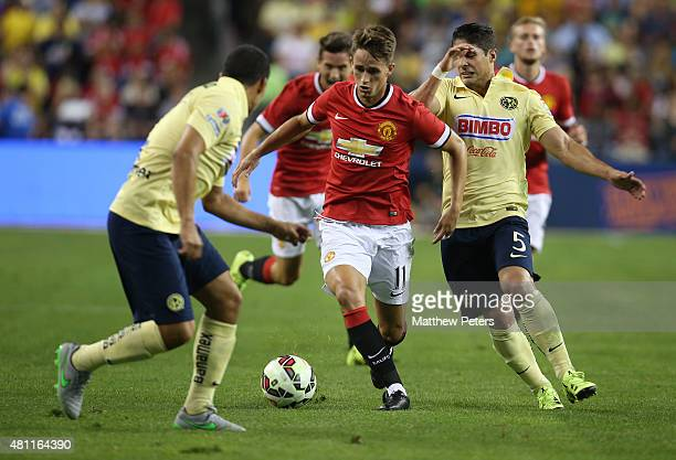 Adnan Januzaj of Manchester United in action with Javier Guemez of Club America during the International Champions Cup 2015 match between Manchester...