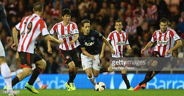 Adnan Januzaj of Manchester United in action with Ki SungYeung and Emanuele Giaccherini of Sunderland during the Barclays Premier League match...