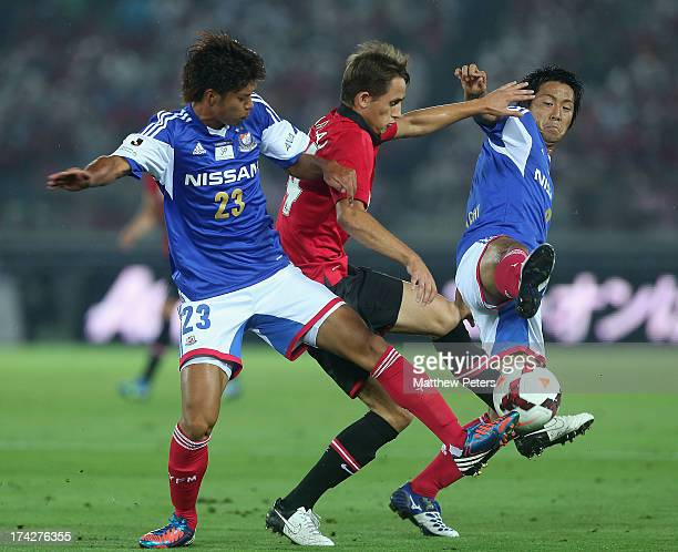 Adnan Januzaj of Manchester United in action with Masakazu Tashiro and Kosuke Nakamachi of Yokohama F Marinos during the preseason friendly match...