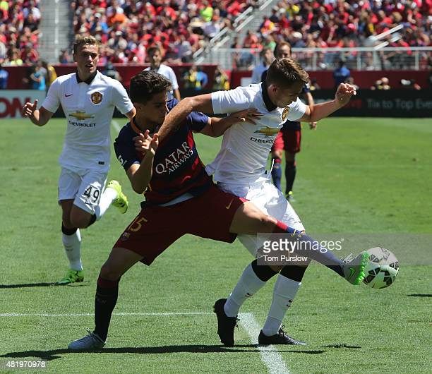 Adnan Januzaj of Manchester United in action with Munir El Haddadi of Barcelona during the International Champions Cup 2015 match between Manchester...