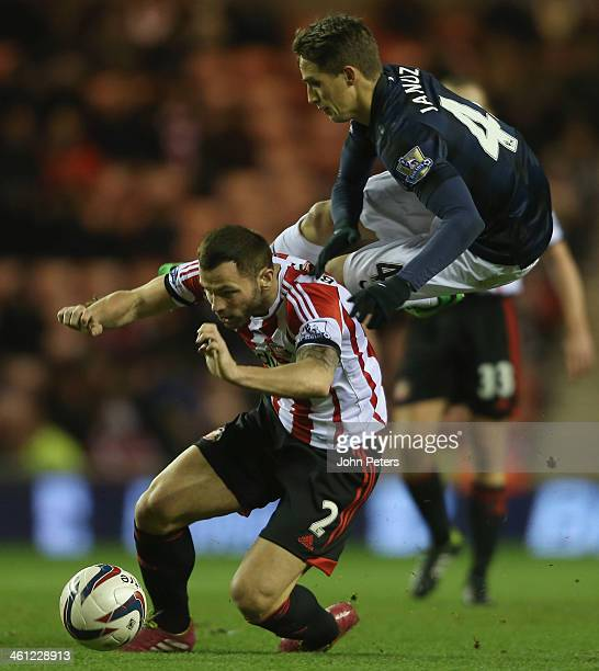 Adnan Januzaj of Manchester United in action with Phil Bardsley of Sunderland during the Capital One Cup SemiFinal first leg between Sunderland and...