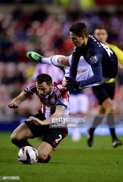 Adnan Januzaj of Manchester United is challenged by Phil Bardsley of Sunderland during the Capital One Cup SemiFinal first leg match between...