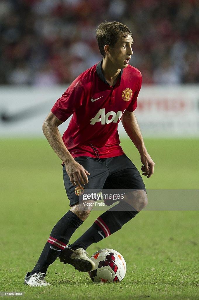 Adnan Januzaj of Manchester United runs with the ball during the international friendly match between Kitchee FC and Manchester United at Hong Kong Stadium on July 29, 2013 in So Kon Po, Hong Kong.