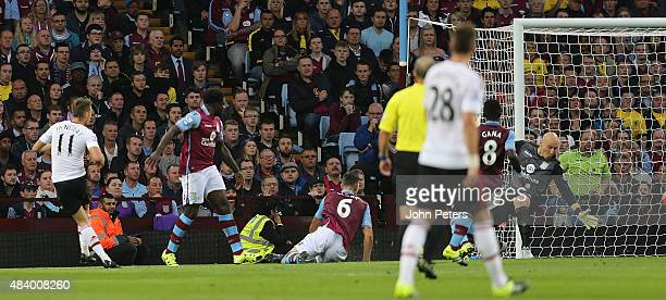 Adnan Januzaj of Manchester United scores the first goal during the Barclays Premier League match between Aston Villa and Manchester United at Villa...