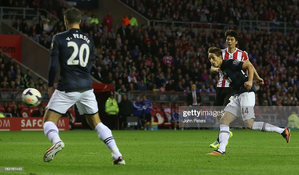 <a gi-track='captionPersonalityLinkClicked' href=/galleries/search?phrase=Adnan+Januzaj&family=editorial&specificpeople=8291259 ng-click='$event.stopPropagation()'>Adnan Januzaj</a> of Manchester United scores their first goal during the Barclays Premier League match between Sunderland and Manchester United at the Stadium of Light on October 5, 2013 in Sunderland, England.