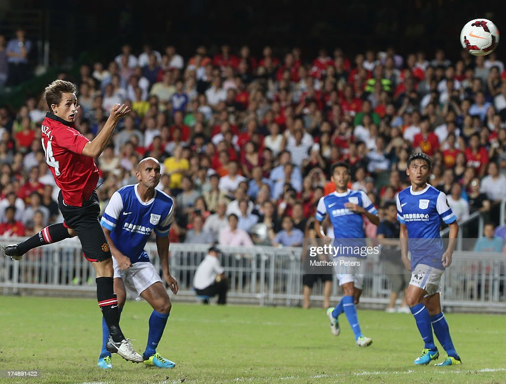 Adnan Januzaj of Manchester United scores their fourth goal during the pre-season friendly match between Kitchee FC and Manchester United as part of their pre-season tour of Bangkok, Australia, Japan and Hong Kong at Hong Kong Stadium on July 29, 2013 in So Kon Po, Hong Kong.