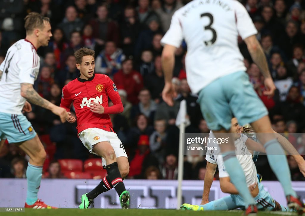 <a gi-track='captionPersonalityLinkClicked' href=/galleries/search?phrase=Adnan+Januzaj&family=editorial&specificpeople=8291259 ng-click='$event.stopPropagation()'>Adnan Januzaj</a> of Manchester United scores their second goal during the Barclays Premier League match between Manchester United and West Ham United at Old Trafford on December 21, 2013 in Manchester, England.
