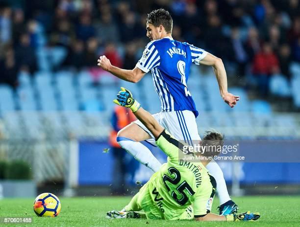 Adnan Januzaj of Real Sociedad being fouled by Dimitrovic of SD Eibar during the La Liga match between Real Sociedad and Eibar at Estadio Anoeta on...