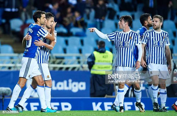 Adnan Januzaj of Real Sociedad celebrates after scoring the second goal for Real Sociedad with his team mates Xabier Prieto of Real Sociedad and...