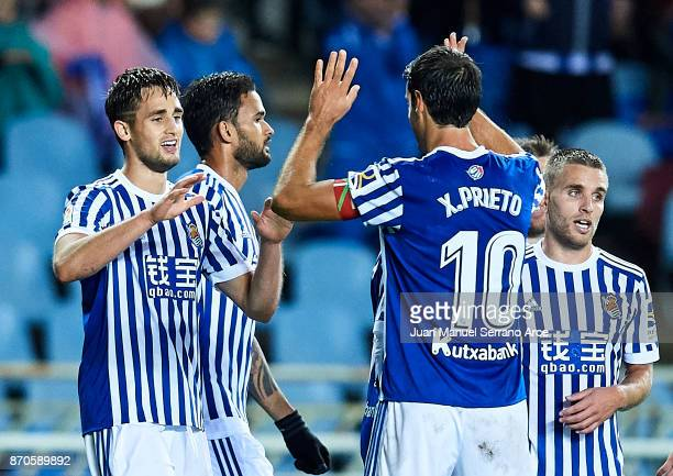 Adnan Januzaj of Real Sociedad celebrates after scoring the second goal for Real Sociedad with his team mate Xabier Prieto of Real Sociedad during...