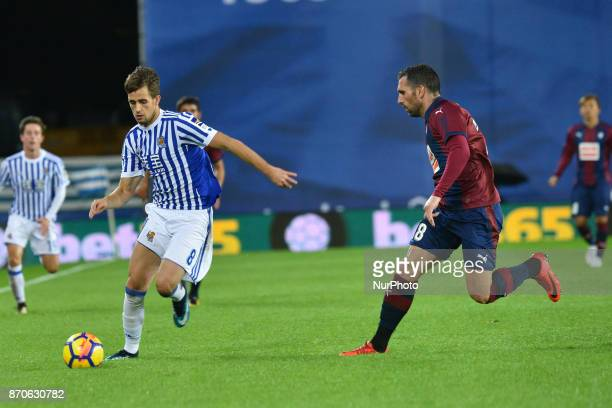 Adnan Januzaj of Real Sociedad duels for the ball with Anaitz Arbilla of Eibar during the Spanish league football match between Real Sociedad and...