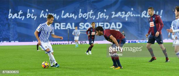 Adnan Januzaj of Real Sociedad duels for the ball with Cote of Eibar during the Spanish league football match between Real Sociedad and Eibar at the...