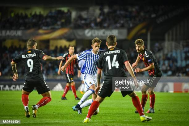 Adnan Januzaj of Real Sociedad duels for the ball with Dejan Blazevski Darko Velkoski and Hovhannes Hambartsumyan of FK Vardar during the UEFA Europa...