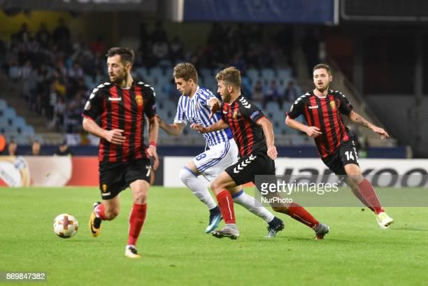 Adnan Januzaj of Real Sociedad duels for the ball with Hovhannes Hambartsumyan Darko Velkoski and Juan Felipe of FK Vardarduring the UEFA Europa...