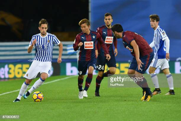 Adnan Januzaj of Real Sociedad duels for the ball with Takashi Inui Jordan and Cote of Eibar during the Spanish league football match between Real...