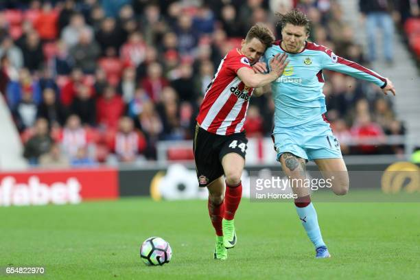 Adnan Januzaj of Sunderland can not shake off Jeff Hendrick of Burnley during the Premier League match between Sunderland and Burnley at Stadium of...