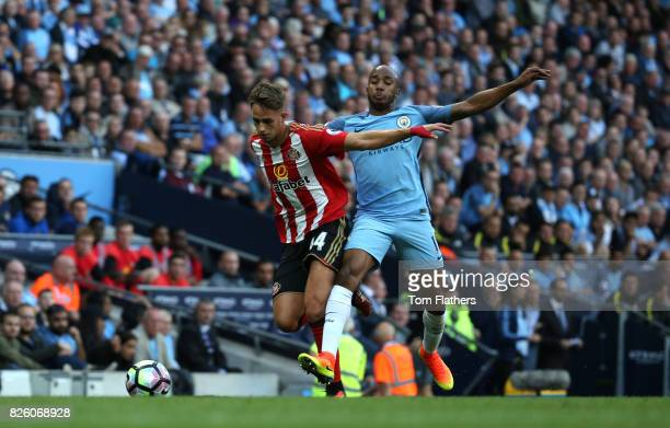 Adnan Januzaj of Sunderland competes with Fabian Delph of Manchester City during the Barclays Premier League match between Manchester City and AFC...