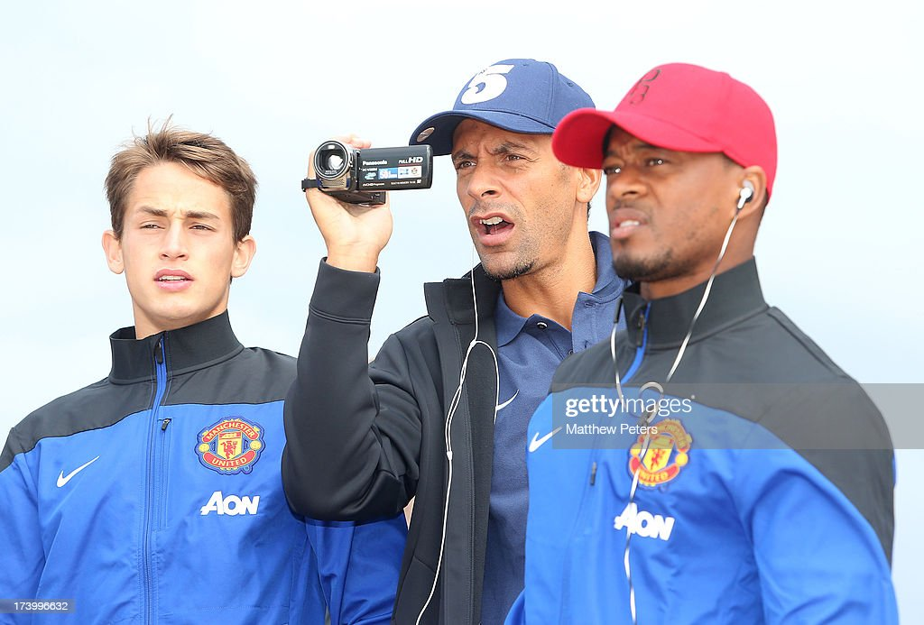 <a gi-track='captionPersonalityLinkClicked' href=/galleries/search?phrase=Adnan+Januzaj&family=editorial&specificpeople=8291259 ng-click='$event.stopPropagation()'>Adnan Januzaj</a>, <a gi-track='captionPersonalityLinkClicked' href=/galleries/search?phrase=Rio+Ferdinand&family=editorial&specificpeople=157538 ng-click='$event.stopPropagation()'>Rio Ferdinand</a> and <a gi-track='captionPersonalityLinkClicked' href=/galleries/search?phrase=Patrice+Evra&family=editorial&specificpeople=714865 ng-click='$event.stopPropagation()'>Patrice Evra</a> of Manchester United visits Manley Beach as part of their pre-season tour of Bangkok, Australia, China, Japan and Hong Kong on July 19, 2013 in Sydney, Australia.