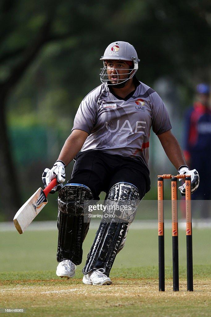 Adnan Kamil Khan of UAE runs during the ACC U-19 Elite Cup Semi Final against Nepal at the Bayuemas Cricket Ground on May 10, 2013 in Kuala Lumpur, Malaysia.