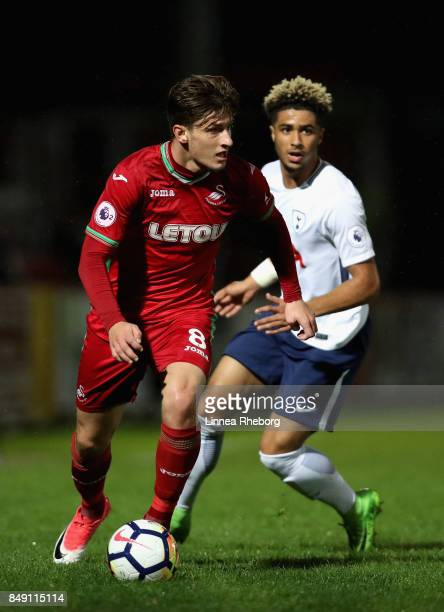 Adnan Maric of Swansea City and Keanan Bennetts of Tottenham Hotspur during the Premier League 2 match between Tottenham Hotspur and Swansea City at...