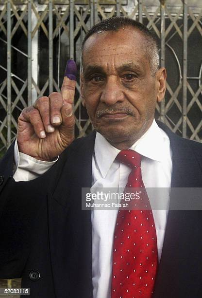 Adnan Mehdi member of the Iraqi communist party who said that he was the first man to vote at his polling station shows his finger marked with ink on...