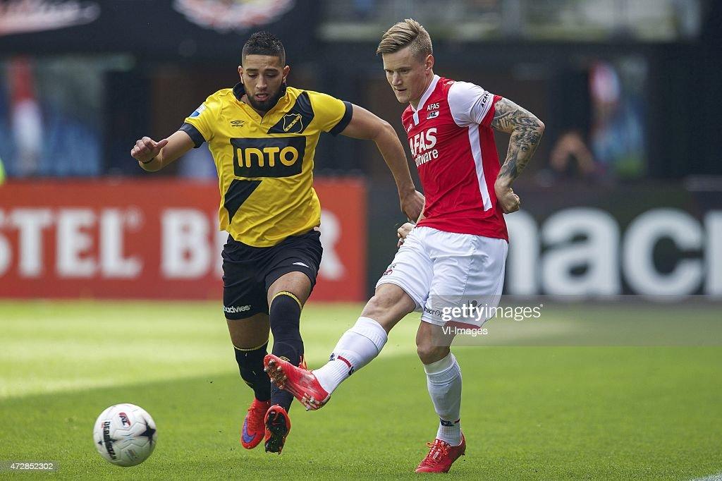 Adnane Tighadouini of NAC Breda, Mattias Johansson of AZ during the Dutch Eredivisie match between AZ Alkmaar and NAC Breda at AFAS stadium on May 10, 2015 in Alkmaar, The Netherlands