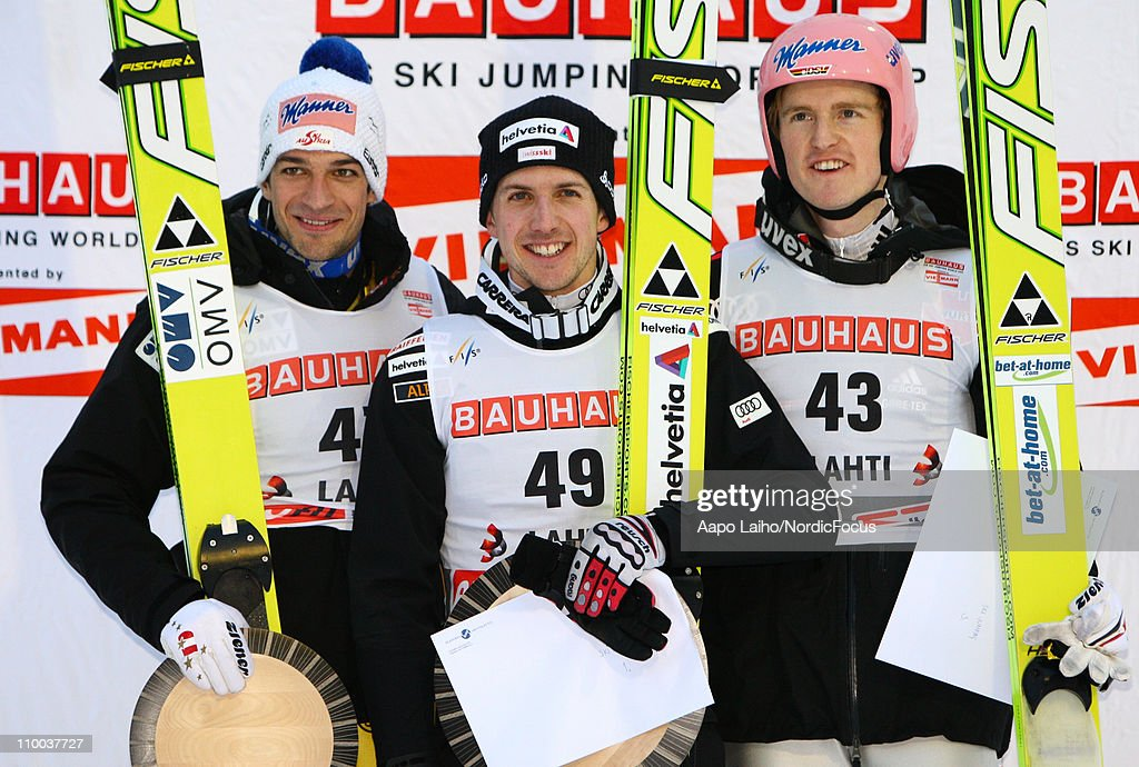 Adnreas Kofler of Austria, Simon Ammann of Switzerland and Severin Freund of Germany (L-R) pose on the podium after the large hill, HS130, during the FIS Ski Jumping World Cup on March 13, 2011, in Lahti, Finland.