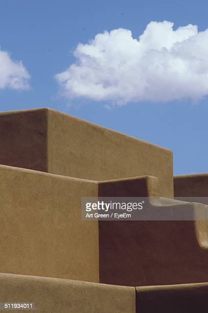 Adobe building rooftop with blue sky