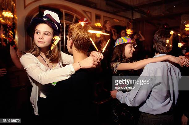 Adolescent boys and girls dance together at a bat mitzvah celebration for 13yearold Ali Green The reception takes place at a ballroom on Manhattan's...