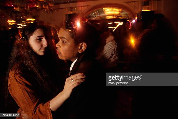 Adolescent girls and boys dance together at a bat mitzvah celebration for 13yearold Ali Green The reception takes place at a ballroom on Manhattan's...