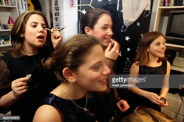 Adolescent girls put on makeup in preparation for Ali Green's bat mitzvah celebration The reception takes place at a ballroom on Manhattan's Fifth...