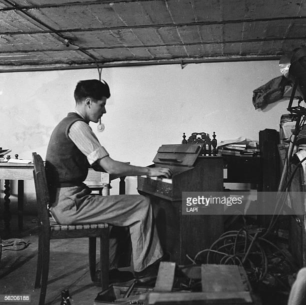 Adolescent playing harmonium France 1951