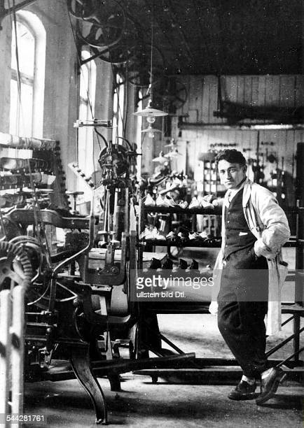 Adolf 'Adi' DASSLER German entrepreneur founder of the German sportswear company 'adidas' Dassler in a shoe factory date unkown c1920s...
