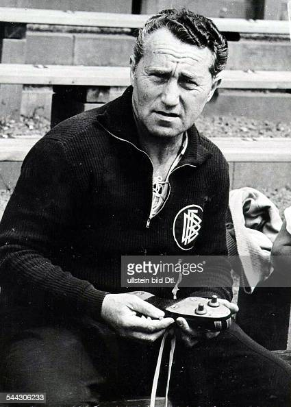Adolf 'Adi' DASSLER German entrepreneur founder of the German sportswear company 'adidas' Dassler in shirt of German football association with...