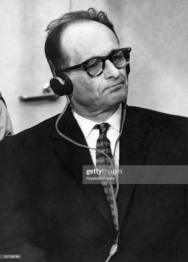 <a gi-track='captionPersonalityLinkClicked' href=/galleries/search?phrase=Adolf+Eichmann&family=editorial&specificpeople=930616 ng-click='$event.stopPropagation()'>Adolf Eichmann</a>, In A Bullet-Proof Cabin, Puts On Earphones To Hear The Reading Of The Act Of Accusation Against Him. To The Left Is His German Lawyer Servatius. Eichmann, A German Nazi Bureaucrat, Was First In Charge Of The Exterminatio December 17, 1961.