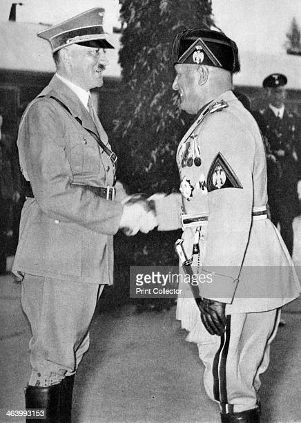 Adolf Hitler and Benito Mussolini c1930sc1940s Hitler leader of Nazi Germany shaking hands with his Axis ally Mussolini dictator of Fascist Italy A...