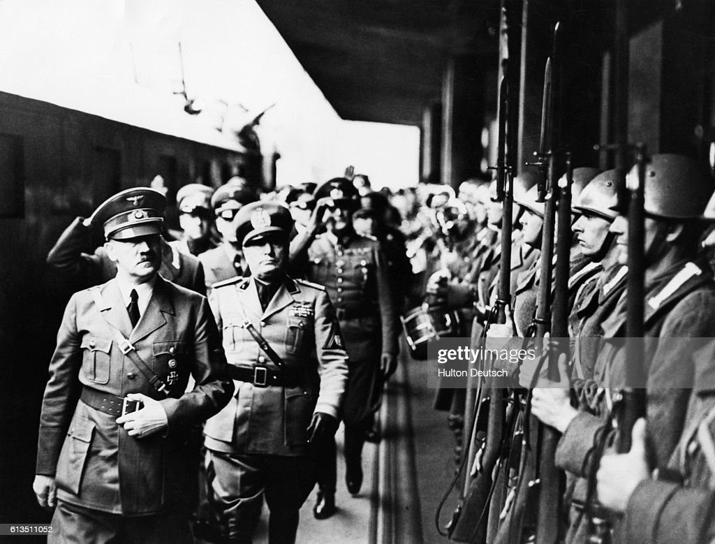 Adolf Hitler and Benito Mussolini review troops in Munich, prior to the conference that would signal the partition of Czechoslovakia.