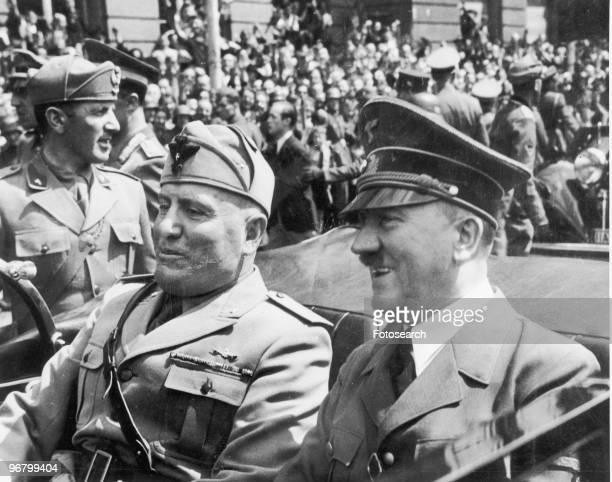 Adolf Hitler and Benito Mussolini riding in an open car circa 1940s