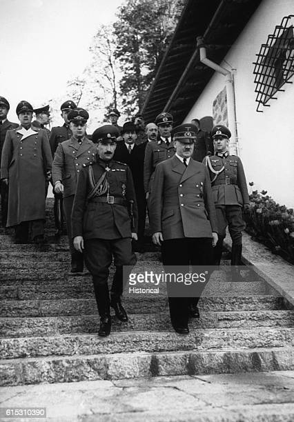 Adolf Hitler and Boris King of Bulgaria followed by several military officers | Location outdoors