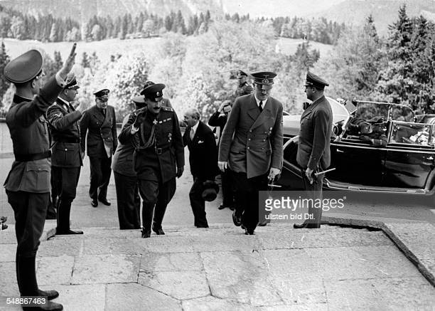 Adolf Hitler and Czar Boris III of Bulgaria on the stepts in front of the Hitler's mountain lodge in the region of the Obersalzberg near...
