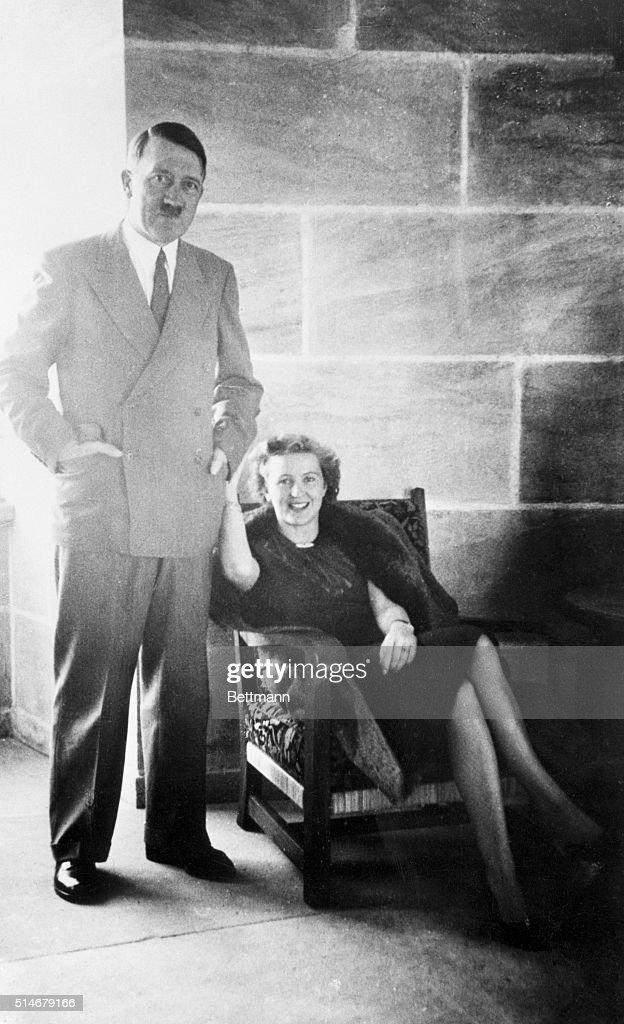 Adolf Hitler (standing) and Eva Braun