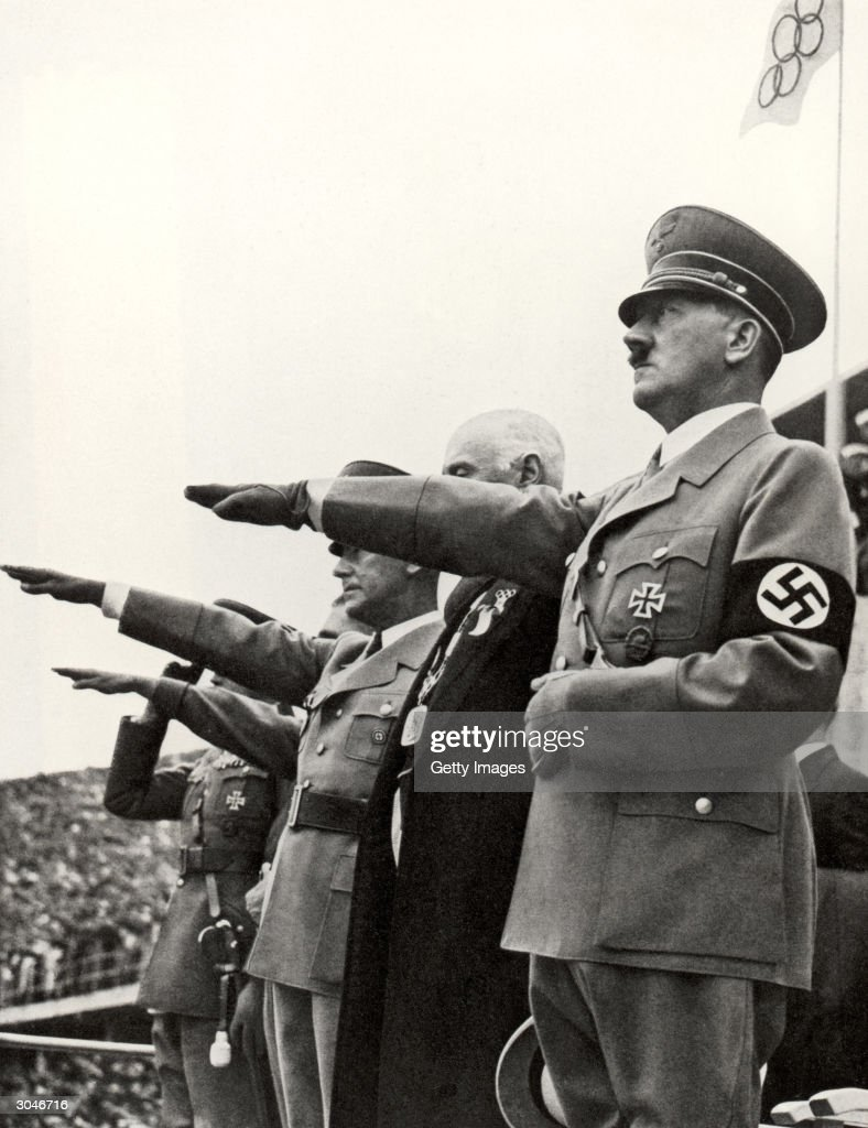 Adolf Hitler and his staff salute the teams during the opening ceremonies of the XI Olympic Games on August 1 936 in Berlin Germany