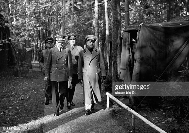 Adolf Hitler and the italian foreign minister Galeazzo Graf Ciano going for a walk near the Fuehrer's headquarters 'Wolfsschanze' near Rastenburg in...